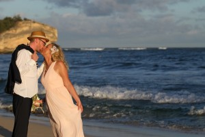 kauai bride and groom kissing at shipwreck beach