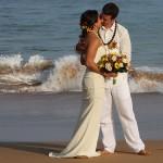 Kauai wedding couple kissing on beach