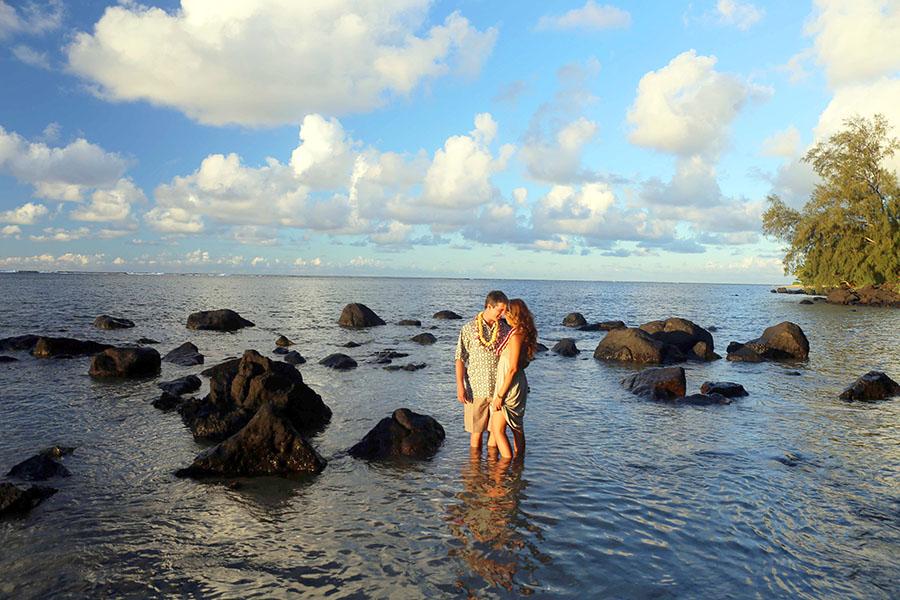 romantic kauai wedding couple standing in ocean