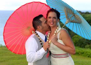 Wedding Couple under umbrella